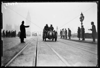 Vintage car crossing Westminster Bridge  c 1935.