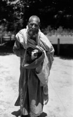 Indian beggar with begging bowl  c 1910s.