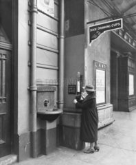 Passenger at a drinking fountain at Chester station  Cheshire  1921.