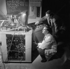 Two engineers test early colour television 1954.
