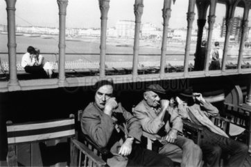 Three elderly males relaxing in chairs  1968.