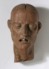 Carved wooden head of a Christian martyr  French  1501-1600.