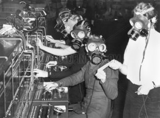 Telephone exchange operators in gas masks  31 October 1938.