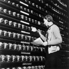 Woman working in a Royal Air Force ammuniti