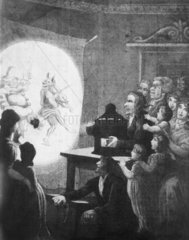 Magic lantern show  c 1820. Acquatint.