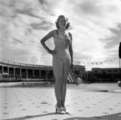 Woman in a bikini posing for camera  c 1930s.