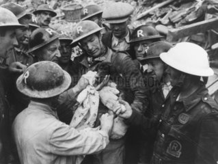 Rescue of a puppy during the Blitz  South London  c 1940.