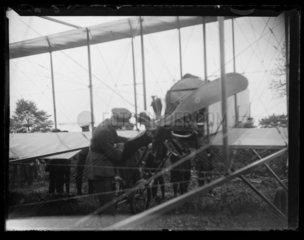 'Pilot Inspecting Aeroplane Propeller'  c 1910.