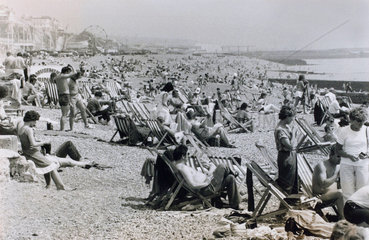 Holiday makers on the Sussex coast  July 1983.