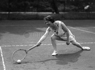 Woman tennis player posing for camera  c 19