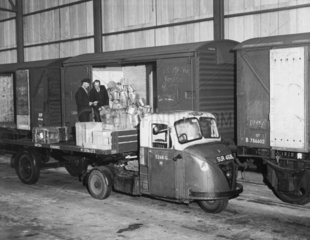 BR mechanical horse being loaded from wagons  c 1950s?
