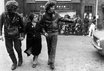 Hell's Saints bikers help an old lady across the road  August 1970.
