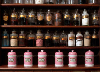 Shelves containing pharmaceutical bottles and jars  late 19th early 20th century.