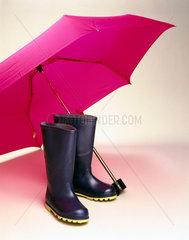 Umbrella and wellington boots  1998.