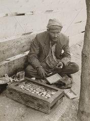 Wandering watchmaker with his workshop  Jerusalem  1939.