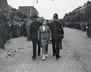 Policemen making an arrest  London  4 July 1937.