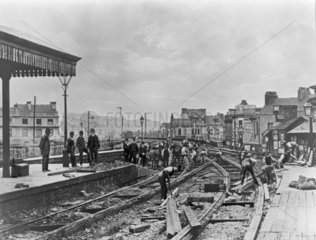 Broad gauge lines being taken up at Plymouth  late 19th century.