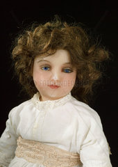 Poured wax doll  French  c 1900.