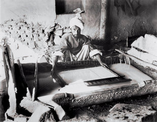 Vatman forming a sheet of paper in Kashmir  India  1917.