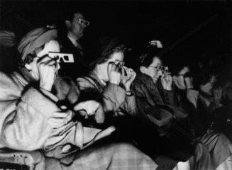 Audience watching a 3D film  c 1940s.