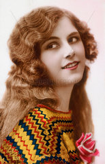Portrait of a girl  tinted photographic postcard  c 1905.