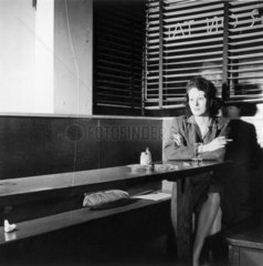 Girl sitting alone in the Sea Grill  waiting for a pickup  Washington DC  April 1943.