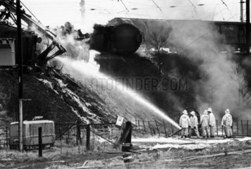 Firefighters dousing burning petrol tankers  Moore  Cheshire  1983.