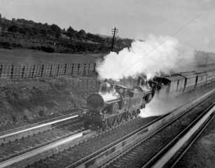 LNWR locomotive passing over Whitmore water