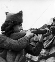 Woman in the firing line  19 July 1938.