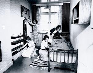 Schoolgirls cleaning  5 October 1953.
