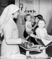 Weighing babies at Putney's Children's Health Centre  2 December 1936.