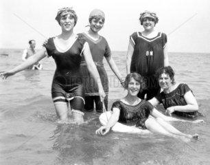 Women paddling in the sea  c 1920s.