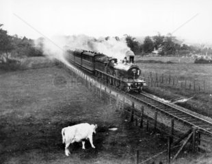 M & GNR Class C 4-4-0 no 79 going through