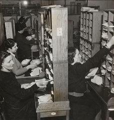 Sorting envelopes at the Unity Pools headquarters  24 Februaury 1940.