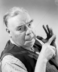 Portrait of a man counting on his fingers  1949.