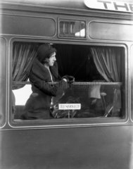 Woman leaning from the window of a reserved