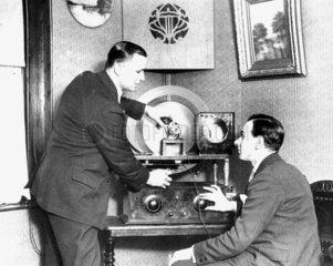 Operating radio equipment  c 1930s.