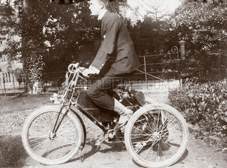 C S Rolls sitting on a de Dion tricycle  1897.