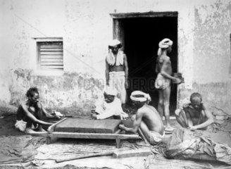 Cutting indigo into cakes  Allahabad  India  1877.
