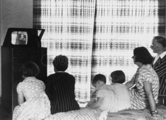 A family watching a television broadcast  c 1930s.