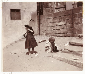 Two children playing  c 1905.