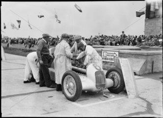Mechanics working on a Mercedes-Benz  German Grand Prix  Nurburgring  1934.
