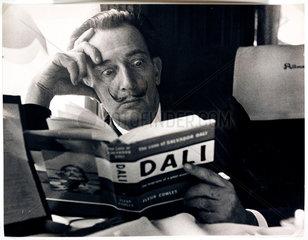 Salvador Dali reading his biography  6 May  1959.