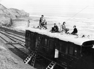 Women on holiday in a camping coach at Sandsend  c 1936.