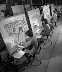 A row of women work on cable forming sections of computer at English Electric.
