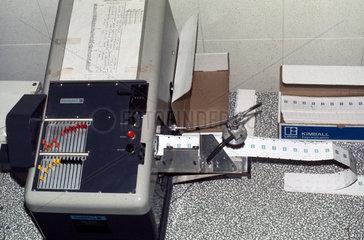 Kimball punch machine at Mothercare  1975.