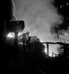 Molten steel pours from a Bessemer furnace at Consett Iron Company  1956.