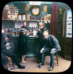 Men and child in a bar  c 1895.