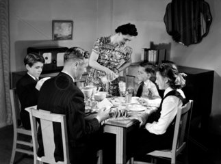 Family at breakfast  c 1948.