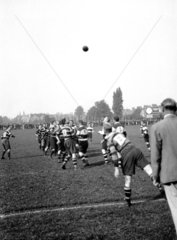 Line out during a rugby match  c 1920s.